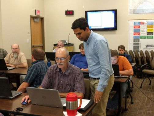 GeoTREE student Arif Masrur works to help workshop participant